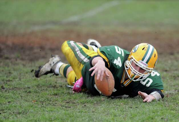 Trinity Catholic's Robert Tusch recovers his own team's kickoff during Saturday's football game at Trinity Catholic High School on November 10, 2012. Photo: Lindsay Niegelberg / Stamford Advocate