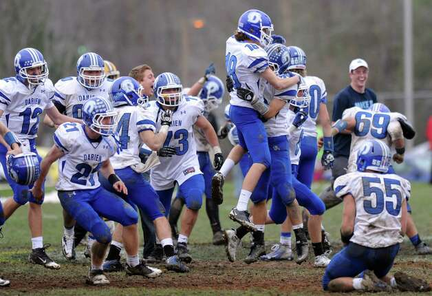 Darien players react after they won Saturday's football game at Trinity Catholic High School on November 10, 2012. Photo: Lindsay Niegelberg / Stamford Advocate