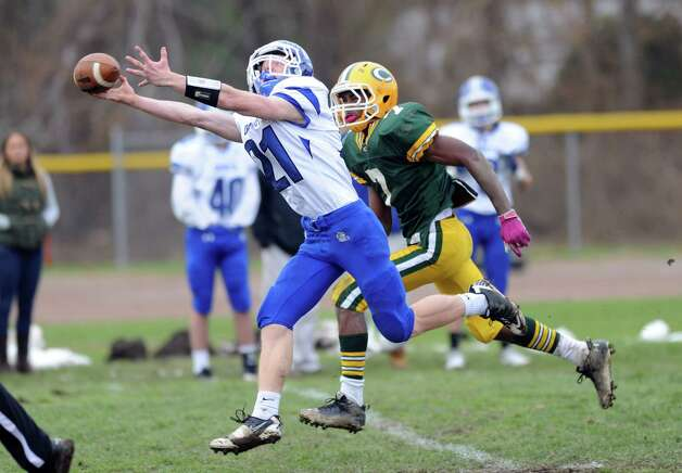 Darien's Nicholas Lombardo reaches for a pass that fell incomplete during Saturday's football game at Trinity Catholic High School on November 10, 2012. Photo: Lindsay Niegelberg / Stamford Advocate
