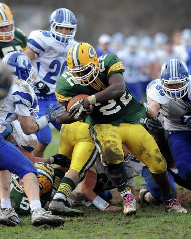Trinity Catholic's Shaquan Howsie carries the ball during Saturday's football game at Trinity Catholic High School on November 10, 2012. Photo: Lindsay Niegelberg / Stamford Advocate