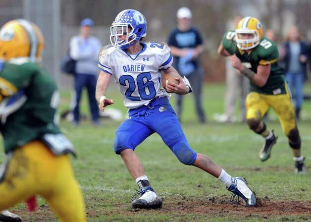 Darien's Peter Gesualdi carries the ball during Saturday's football game at Trinity Catholic High School on November 10, 2012. Photo: Lindsay Niegelberg / Stamford Advocate