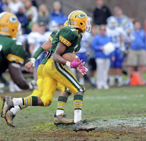 Trinity Catholic's Neno Merritt catches and runs with an interception during Saturday's football game at Trinity Catholic High School on November 10, 2012. Photo: Lindsay Niegelberg / Stamford Advocate