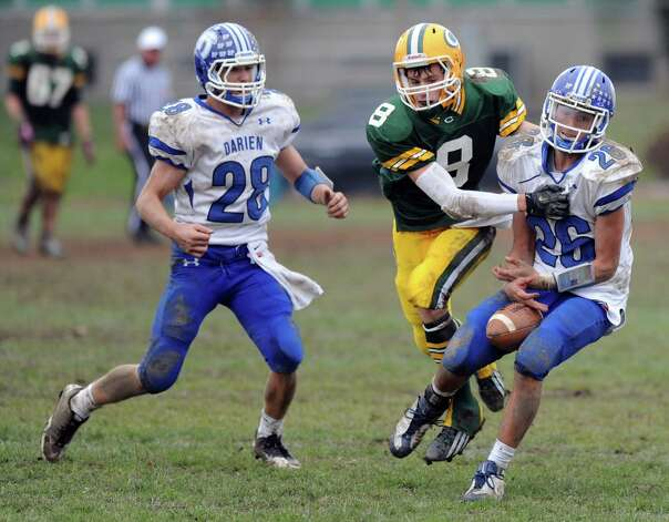 Darien's Peter Gesualdi can't hold on to a near-interception during Saturday's football game at Trinity Catholic High School on November 10, 2012. Photo: Lindsay Niegelberg / Stamford Advocate