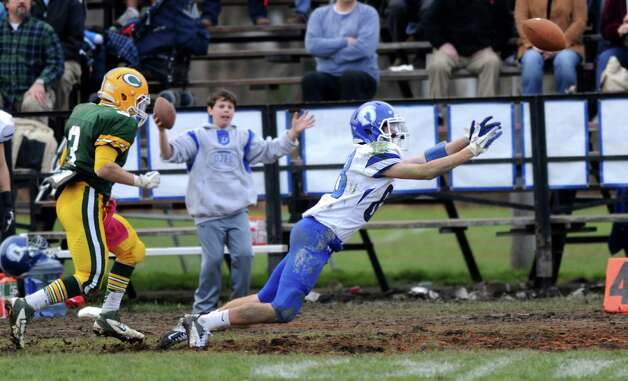 Darien's Kyle Gifford reaches for a pass that fell incomplete during Saturday's football game at Trinity Catholic High School on November 10, 2012. Photo: Lindsay Niegelberg / Stamford Advocate