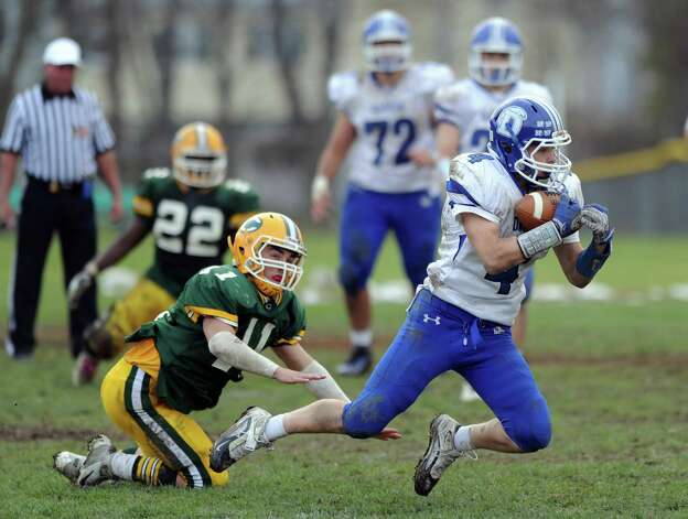 Darien's Jackson Whiting makes a catch during Saturday's football game at Trinity Catholic High School on November 10, 2012. Photo: Lindsay Niegelberg / Stamford Advocate