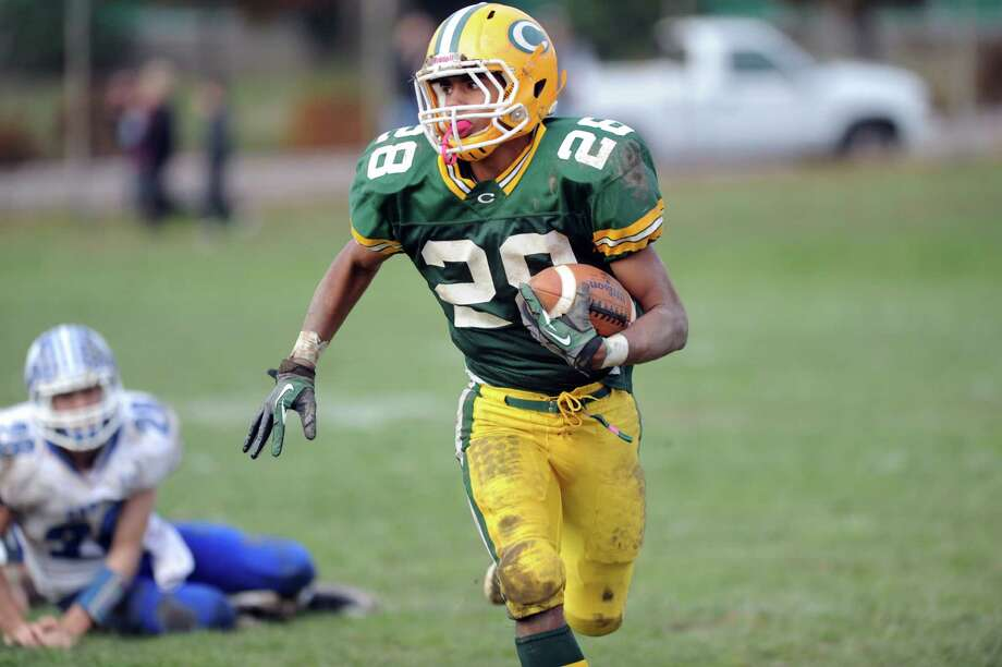 Trinity Catholic's Randy Polonia carries the ball during Saturday's football game against Darien at Trinity Catholic High School on November 10, 2012. Photo: Lindsay Niegelberg / Stamford Advocate