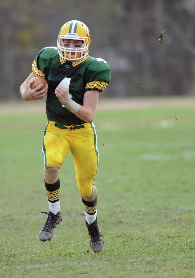 Trinity Catholic's Danny O'Leary carries the ball during Saturday's football game against Darien at Trinity Catholic High School on November 10, 2012. Photo: Lindsay Niegelberg / Stamford Advocate