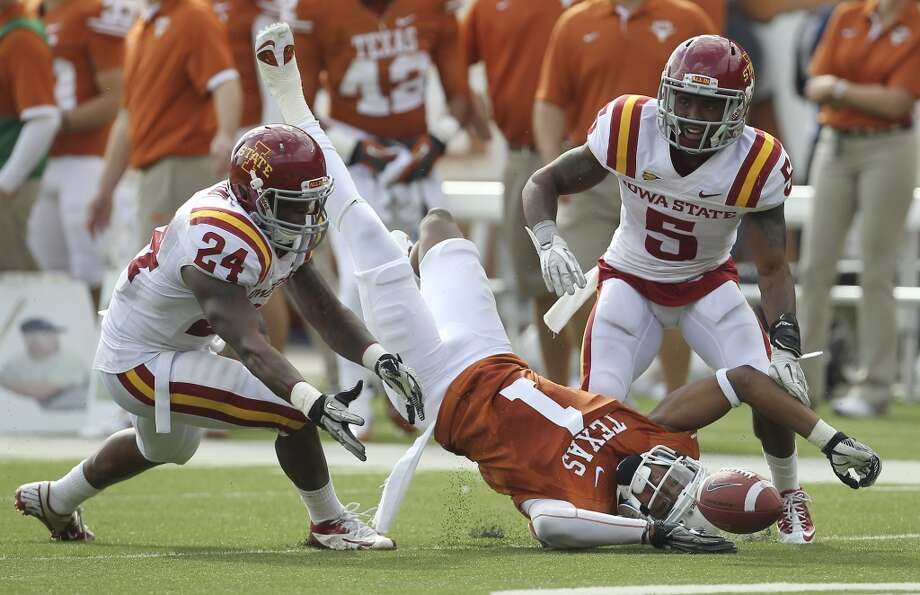 Texas Longhorns' Mike Davis (01) attempts a catch between Iowa State defenders Durrell Givens (24) and Jeremy Reeves (05) in the second half at Darrell K. Royal Stadium in Austin on Saturday, Nov. 10, 2012. Texas defeated Iowa State, 33-7. (Kin Man Hui / San Antonio Express-News)