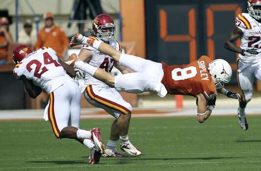 Texas Longhorns' Jaxon Shipley get knocked off his feet after a reception by Iowa State's Durrell Givens (24) in the second half at Darrell K. Royal Stadium in Austin on Saturday, Nov. 10, 2012. Texas defeated Iowa State, 33-7. (Kin Man Hui / San Antonio Express-News)