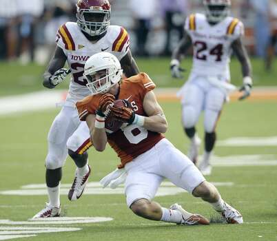 Texas Longhorns' Jaxon Shipley (08) makes a catch in front of Iowa State's C.J. Morgan (27) in the second half at Darrell K. Royal Stadium in Austin on Saturday, Nov. 10, 2012. Texas defeated Iowa State, 33-7. (Kin Man Hui / San Antonio Express-News)