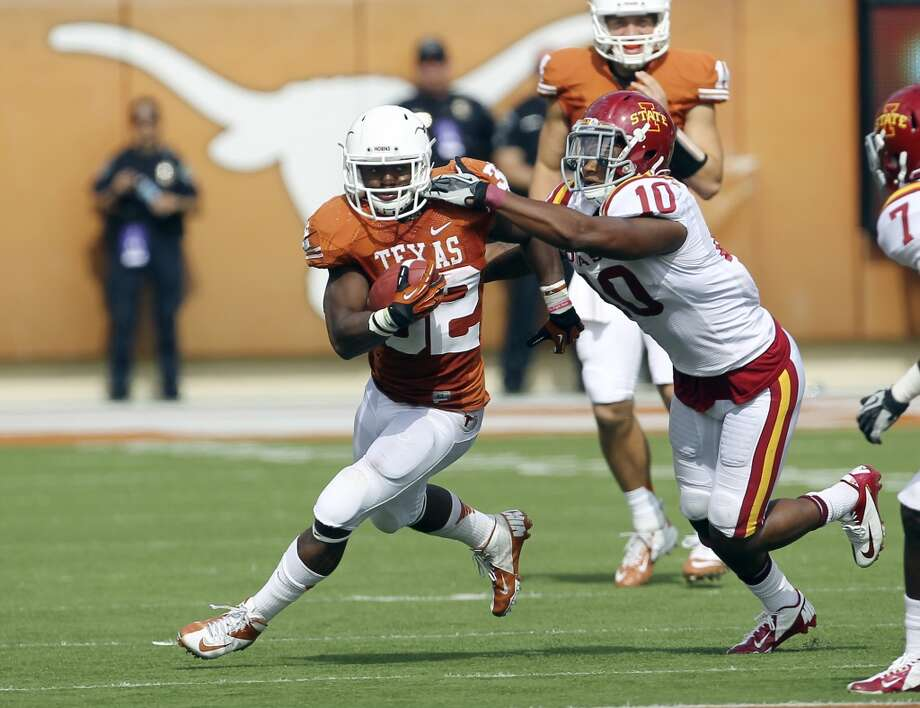 Texas Longhorns' Johnathan Gray (32) runs from Iowa State's Jacques Washington (10) in the second half at Darrell K. Royal Stadium in Austin on Saturday, Nov. 10, 2012. Texas defeated Iowa State, 33-7. (Kin Man Hui / San Antonio Express-News)