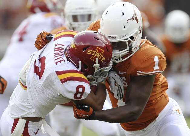 Texas Longhorns' Shiro Davis (01) makes a stop against Iowa State's James White (08) in the second half at Darrell K. Royal Stadium in Austin on Saturday, Nov. 10, 2012. Texas defeated Iowa State, 33-7. (Kin Man Hui / San Antonio Express-News)