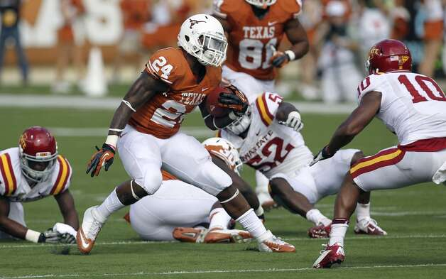 Texas Longhorns' Joe Bergeron (24) makes a cut away from Iowa State's Jacques Washington (10) in the second half at Darrell K. Royal Stadium in Austin on Saturday, Nov. 10, 2012. Texas defeated Iowa State, 33-7. (Kin Man Hui / San Antonio Express-News)