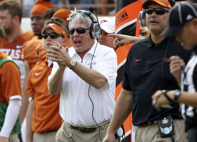 Texas Longhorns head coach Mack Brown applauds his team during the game against Iowa State in the second half at Darrell K. Royal Stadium in Austin on Saturday, Nov. 10, 2012. Texas defeated Iowa State, 33-7. (Kin Man Hui / San Antonio Express-News)