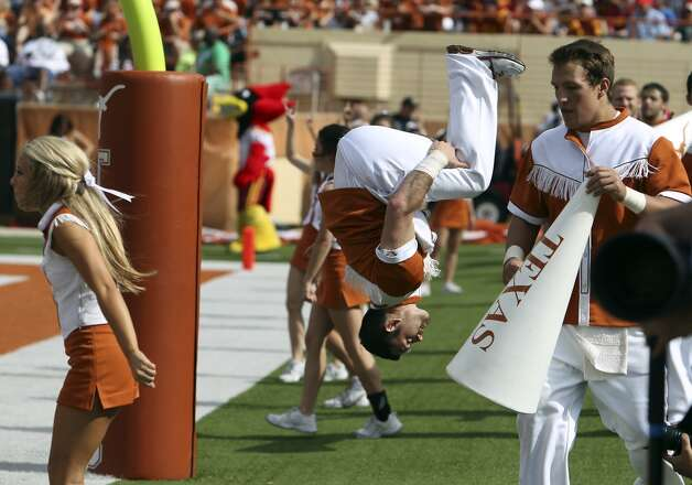 Texas Longhorns cheerleaders flip in the air after a score against Iowa State in the second half at Darrell K. Royal Stadium in Austin on Saturday, Nov. 10, 2012. Texas defeated Iowa State, 33-7. (Kin Man Hui / San Antonio Express-News)