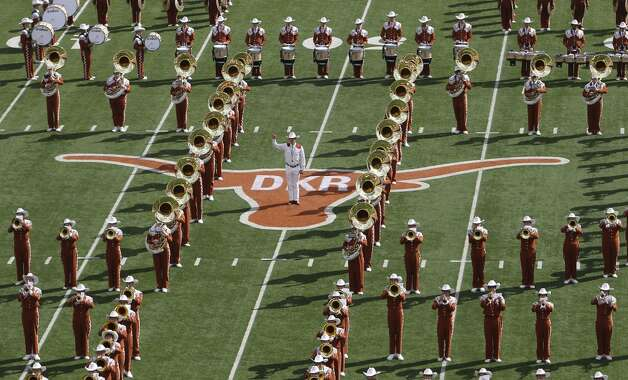 The Texas Longhorns marching band performs at mid-field on the Longhorn logo containing the initials of former coach Darrell K. Royal who passed away on Wednesday prior to the game against Iowa State at Darrell K. Royal Stadium in Austin on Saturday, Nov. 10, 2012. (Kin Man Hui / San Antonio Express-News)