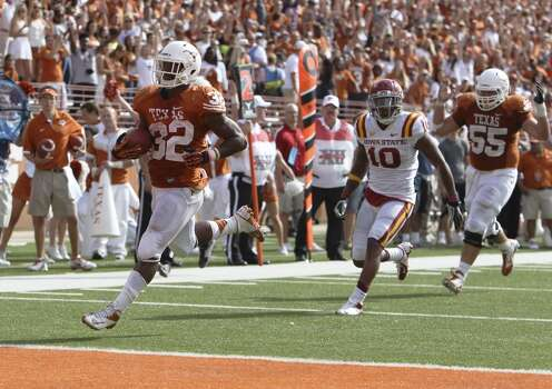 Texas Longhorns' Johnathan Gray (32) cruises in for a second half touchdown against Iowa State at Darrell K. Royal Stadium in Austin on Saturday, Nov. 10, 2012. Texas defeated Iowa State, 33-7. (Kin Man Hui / San Antonio Express-News)