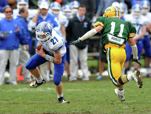 Darien's Nicholas Lombardo carries the ball during Saturday's football game at Trinity Catholic High School on November 10, 2012. Photo: Lindsay Niegelberg / Stamford Advocate