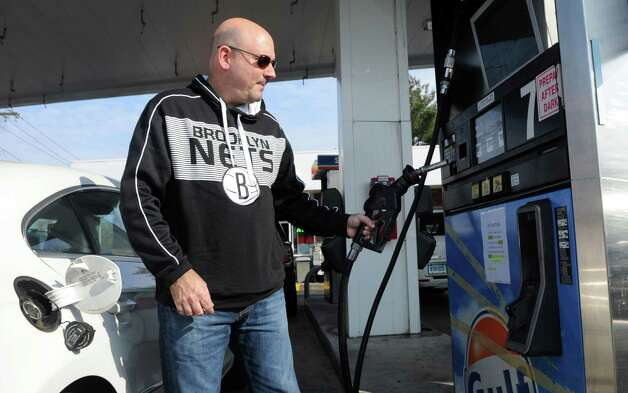 Long Island resident Ben Bongiovi fills his car with gas at the Gulf station on East Main Street off exit 9 on I-95 on Saturday, November 10, 2012. Photo: Lindsay Niegelberg / Stamford Advocate