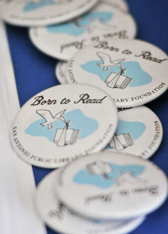 Born to Read buttoms were distributed to those attending the 9th Annual Express-News Book Celebration at the Tripoint YMAC Saturday. Photo: Express-News