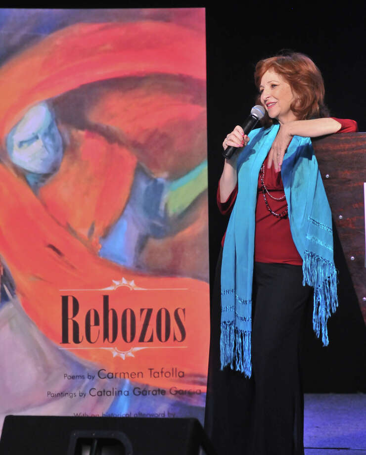 San Antonio author and Poet Laureat Carmen Tafolla speaks in front of an enlargement of her book, Rebozos, during the 9th annual San Antonio Express-News Children's Book Celebration Saturday at the Tripoint YMCA. Photo: Express-News