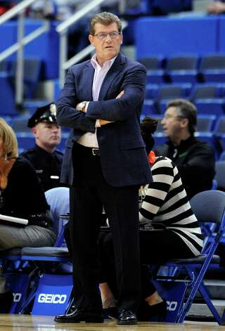 Connecticut coach Geno Auriemma watches his team during the first half of their 119-50 victory over Holy Family in an exhibition NCAA college basketball game in Hartford, Conn., Wednesday, Nov. 7, 2012. (AP Photo/Fred Beckham) Photo: Fred Beckham, Associated Press / FR153656 AP