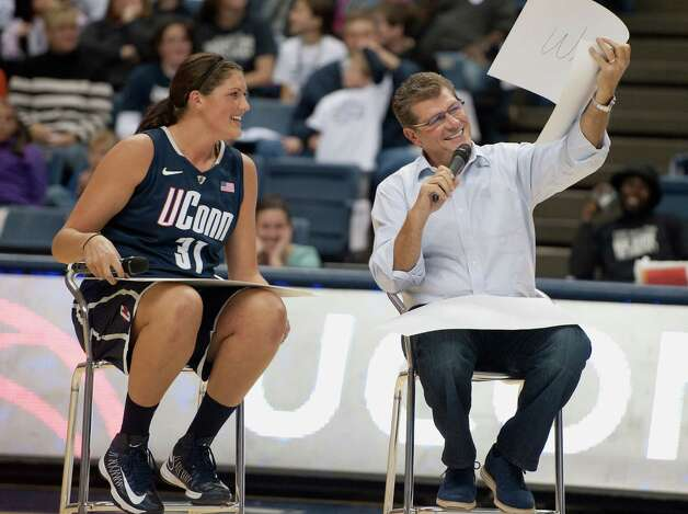 "Connecticut's head coach Geno Auriemma, right, shares his answer with player Stefanie Dolson during a ""match game"" at the NCAA college basketball teams' First Night event in Storrs, Conn., Friday, Oct. 12, 2012. (AP Photo/Jessica Hill) Photo: Jessica Hill, Associated Press / FR125654 AP"