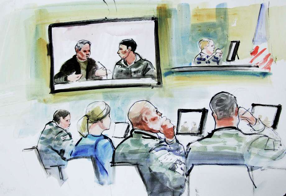 In this courtroom sketch, an Afghan national army guardsman, shown on the right side of the video monitor, testifies in the case of U.S. Army Staff Sgt. Robert Bales, accused of killing 16 Afghan civilians in Kandahar province. If a court-martial is ordered and the Army decides to continue the prosecution as a capital case, Bales could face the death penalty.  Photo: Lois Silver, Associated Press / FR 170774 AP