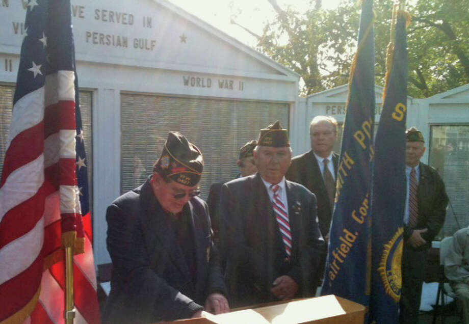 Joseph Bender, at podium, commander of Veterans of Foreign Wars Post 9427, was emcee of the town's Veterans Day Ceremony on Town Hall Green Saturday morning.  Fairfield CT 11/10/12 Photo: Andrew Brophy / Fairfield Citizen contributed