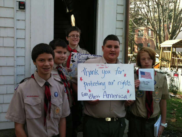 Members of Troop 10 of the Boy Scouts of America greet veterans and residents after the town's annual Veterans Day ceremony at the Old Academy on Town Hall Green.  Fairfield CT 11/10/12 Photo: Andrew Brophy / Fairfield Citizen contributed