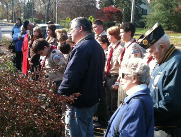 A small gathering was on hand Saturday morning for the annual Veterans Day ceremony at the Honor Roll on Town Hall Green.  Fairfield CT 11/10/12 Photo: Andrew Brophy / Fairfield Citizen contributed