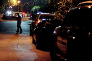 A man heads to Washington Avenue after parking in a neighborhood west of Shepherd on a recent busy Friday night.