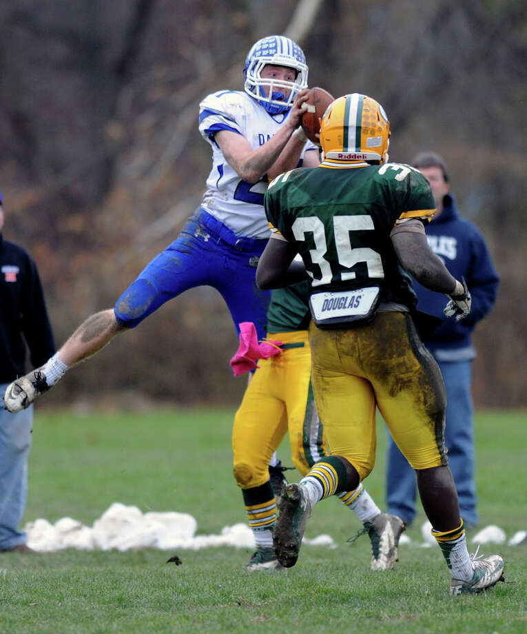 Darien's Nicholas Lombardo makes a catch and dives into the end zone for a tie-breaking touchdown during Saturday's football game at Trinity Catholic High School on November 10, 2012. Photo: Lindsay Niegelberg / Stamford Advocate