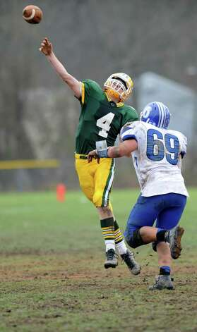 Trinity Catholic's Danny O'Leary throws a pass during Saturday's football game against Darien at Trinity Catholic High School on November 10, 2012. Photo: Lindsay Niegelberg / Stamford Advocate