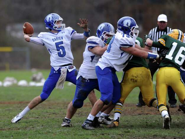 Darien's Henry Baldwin throws a pass during Saturday's football game at Trinity Catholic High School on November 10, 2012. Photo: Lindsay Niegelberg / Stamford Advocate