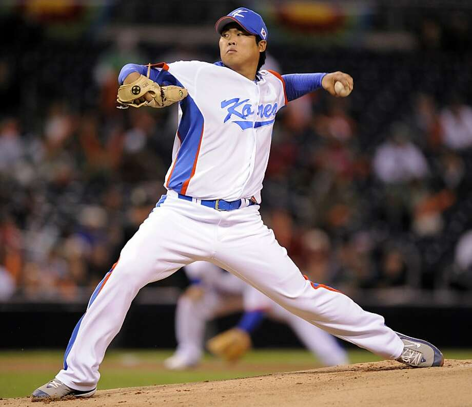 Ryu Hyun-jin is 98-52 with a 2.80 career ERA during seven seasons in South Korea and won a gold medal in 2008. Photo: Mark J. Terrill, Associated Press