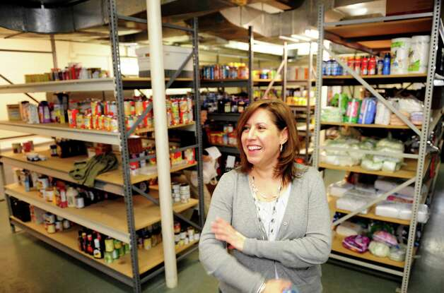 Carla Miklos, director of Operation Hope in Fairfield, says the food pantry has been receiving donations post Hurricane Sandy to replenish their shelves. Photo: Autumn Driscoll / Connecticut Post