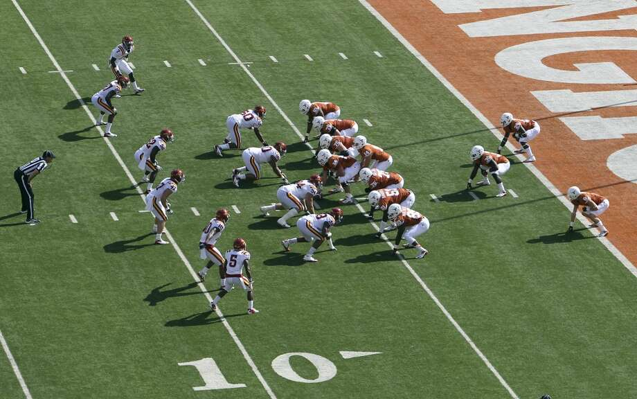 The Texas Longhorns offense line up in the wishbone formation to honor the passing of former Texas coach Darrell K. Royal on their first possession in a game against Iowa State at Darrell K. Royal Stadium in Austin on Saturday, Nov. 10, 2012. (Kin Man Hui / San Antonio Express-News)