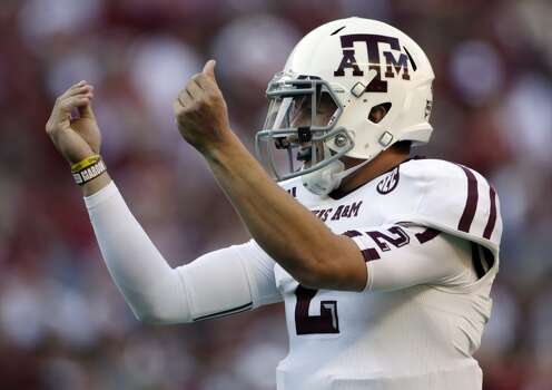 Texas A&M quarterback Johnny Manziel (2) reacts after the Aggies scored their third touchdown of the first quarter against Alabama during the first half of an NCAA college football game at Bryant-Denny Stadium in Tuscaloosa, Ala., Saturday, Nov. 10, 2012. (AP Photo/Dave Martin) (Associated Press)