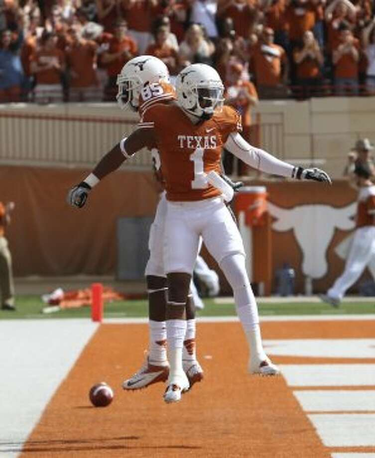 Receiver Mike Davis (1), who still had high hopes for a BCS bowl berth in the midst of UT's worst struggles of the season last month, could be proven right if things fall the Longhorns' way. Kin Man Hui / San Antonio Express-News