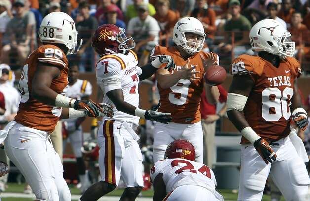 Texas Longhorns kicker Anthony Fera (09) attempts to recover the ball from a blocked kick against Iowa State's Cliff Stokes (07) in the first half at Darrell K. Royal Stadium in Austin on Saturday, Nov. 10, 2012. (Kin Man Hui / San Antonio Express-News)