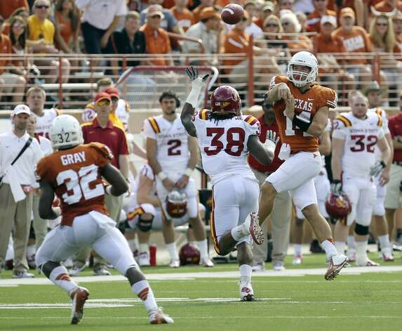 Texas Longhorns quarterback David Ash (14) throws over Iowa State's Roosevelt Maggitt (38) to Longhorn running back Johnathan Gray (32) in the first half at Darrell K. Royal Stadium in Austin on Saturday, Nov. 10, 2012. (Kin Man Hui / San Antonio Express-News)
