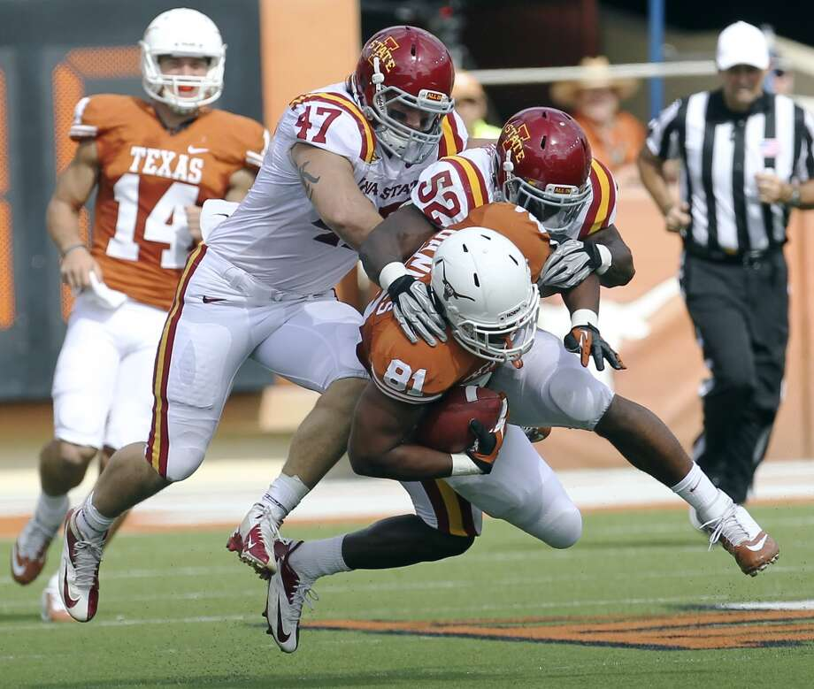 Iowa State's A.J. Klein (47) and Jeremiah George (52) team up to tackle Texas Longhorns' Greg Daniels (81) in the first half at Darrell K. Royal Stadium in Austin on Saturday, Nov. 10, 2012. (Kin Man Hui / San Antonio Express-News)