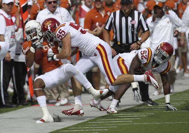 Texas Longhorns' Mike Davis (01) gets knocked out of bounds after a reception by Iowa State's Jevohn Miller (55) in the first half at Darrell K. Royal Stadium in Austin on Saturday, Nov. 10, 2012. (Kin Man Hui / San Antonio Express-News)