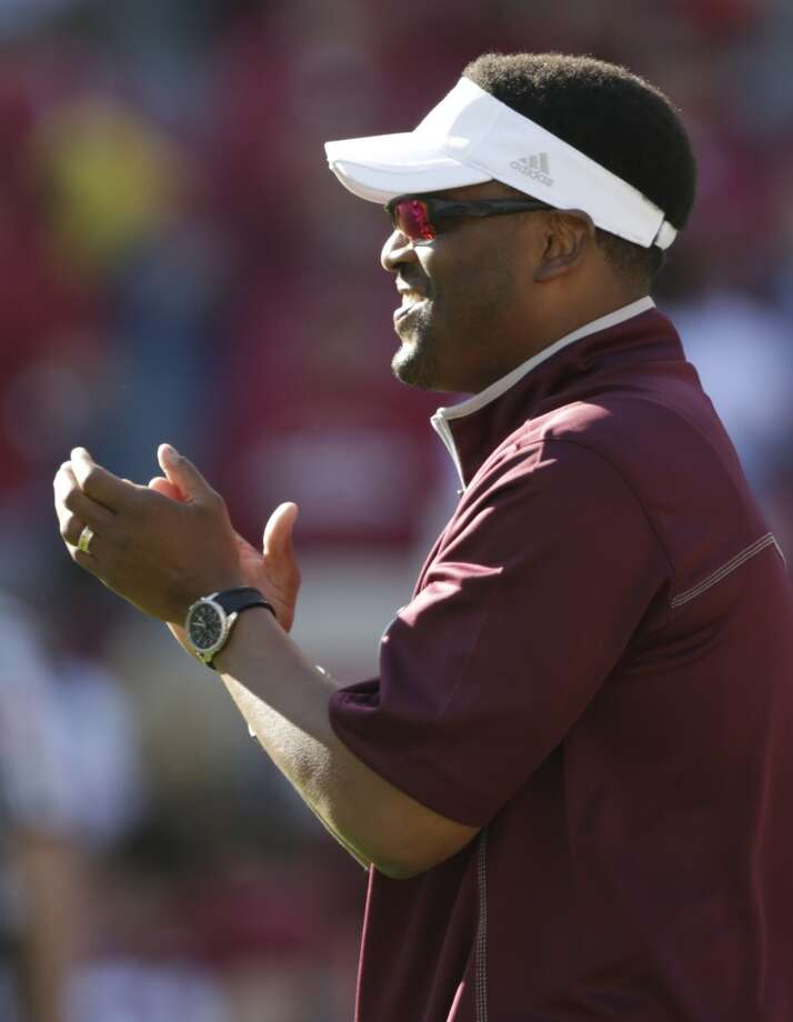 Texas A&M coach Kevin Sumlin applauds his team prior to the start of an NCAA college football game against Alabama at Bryant-Denny Stadium in Tuscaloosa, Ala., Saturday, Nov. 10, 2012. (AP Photo/Dave Martin) (Associated Press)