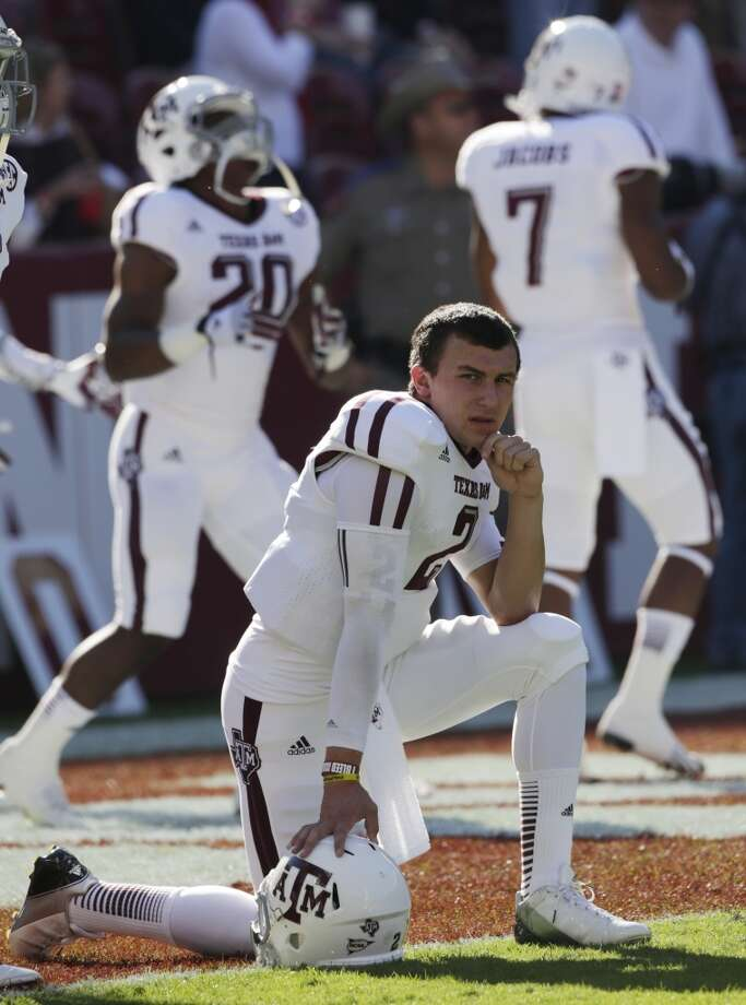 Texas A&M quarterback Johnny Manziel (2) watches the action prior to the start of an NCAA college football game against top ranked Alabama at Bryant-Denny Stadium in Tuscaloosa, Ala., Saturday, Nov. 10, 2012. (AP Photo/Dave Martin) (Associated Press)