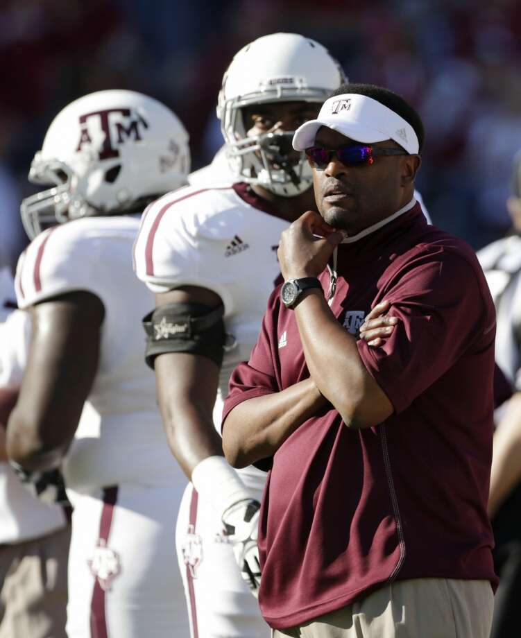 Texas A&M coach Kevin Sumlin watches his team prior to the start of an NCAA college football game against Alabama at Bryant-Denny Stadium in Tuscaloosa, Ala., Saturday, Nov. 10, 2012. (AP Photo/Dave Martin) (Associated Press)