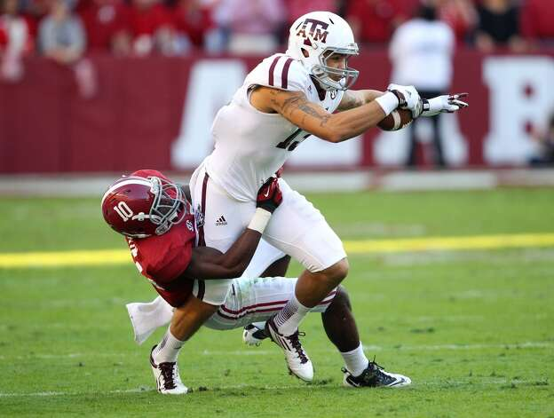 TUSCALOOSA, AL - NOVEMBER 10:  Wide receiver Mike Evans #13 of the Texas A&M Aggies is tackled by cornerback John Fulton #10 of the Alabama Crimson Tide during the game at Bryant-Denny Stadium on November 10, 2012 in Tuscaloosa, Alabama.  (Photo by Mike Zarrilli/Getty Images) (Getty Images)