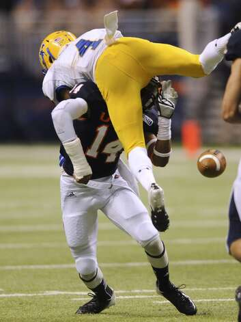 UTSA safety Triston Wade (14) knocks the ball loose from McNeese State receiver Diontae Spencer (4) during first-half college football action in the Alamodome on Saturday, Nov. 10, 2012. (Billy Calzada / San Antonio Express-News)