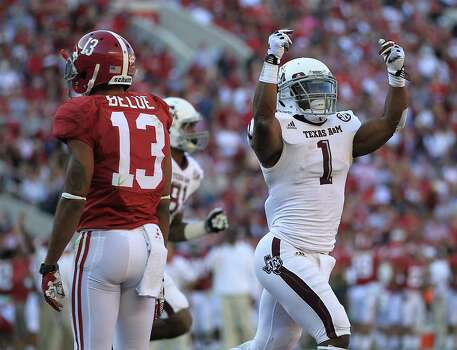 Texas A&M running back Ben Malena (1) reacts during the first quarter of a college football game at Bryant-Denny Stadium, Saturday, Nov. 10, 2012, in Tuscaloosa. Photo: Karen Warren, Houston Chronicle / © 2012  Houston Chronicle